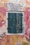 Closed shutters on a window of an old building in Paxoi island, Greece Stock Photo