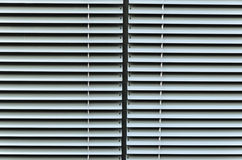 Closed shutters of a window Stock Photo