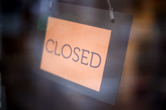Closed sign. In a shop's window. Shallow depth of field Royalty Free Stock Image