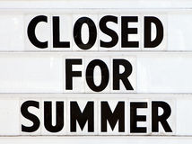 Closed Sign. Large white sign the states closed for summer Stock Images