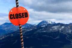 Closed sign. A closed sign is blocking the way to the mountain hill Royalty Free Stock Photography