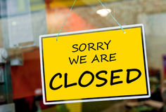 Closed sign. Sorry we are closed sign hanging on a window door outside a restaurant, store, office or other Royalty Free Stock Images