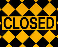 Closed sign. On black and yellow diamonds Stock Images