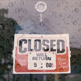 Closed sign board hang on the door. Vintage closed sign in shop window on a rainy day Royalty Free Stock Images