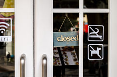 Closed sign board hang and no smoking on the door Royalty Free Stock Image
