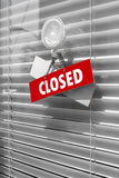 Closed sign board hanging outside store. Close up of closed sign hanging on shop door Stock Photography