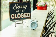 Closed sign board at coffee shop. Closed sign board retro style in the coffee shop royalty free stock photos