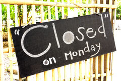 Closed sign on chalk board in a shop front.  Royalty Free Stock Image