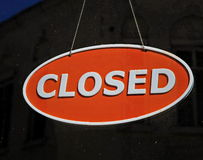 Closed sign on dark background Stock Image