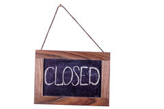 Closed. A sign on the door. Isolated Royalty Free Stock Photography