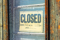 Closed sign on the door. Old wooden door with hanging Closed sign Stock Images