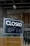 Closed sign. In front of shop Stock Photo