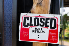 Closed sign in front of store Royalty Free Stock Photography