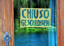 Closed sign in german language. Closed sign in street cafe in german language Royalty Free Stock Photos