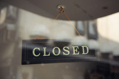CLOSED sign hanging in a window Stock Photos