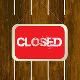 Closed sign hanging on a wooden fence Stock Image