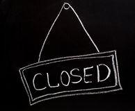 Closed sign made on a blackboard Stock Images