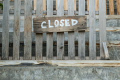 Closed sign. On old wooden fence Stock Image
