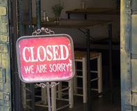 Closed sign outside a shop window. Sorry we are closed Royalty Free Stock Image