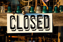 Closed sign posted on a wooden plank Stock Images