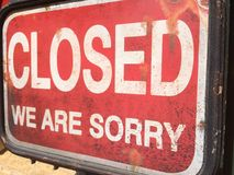Closed. Sign saying Closed we are sorry Stock Photo