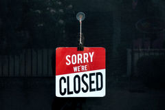 Closed sign in a shop window sorr we are closed Stock Photo