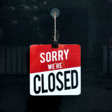 Closed sign in a shop window sorry we are closed.  Royalty Free Stock Photography