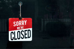 Closed sign in a shop window sorry we are closed.  Royalty Free Stock Photo