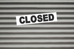 Closed Sign Shutter Door. Closed sign on shutter door entrance stock images