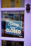 Closed sign. The sign sorry we are closed on the door Royalty Free Stock Image