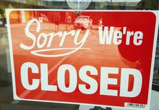 Closed sign. Sorry we& x27;re closed sign in shop window Royalty Free Stock Photography