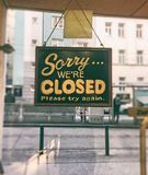 Closed sign on store. Sorry we are closed sign on fast food glass door Royalty Free Stock Photos