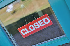Closed sign on window. A closed sign on a door window of a shop Royalty Free Stock Images