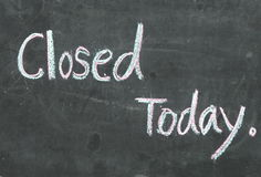 Closed. Signs that today are closed,whitten with color chalk on blackboard Royalty Free Stock Photo