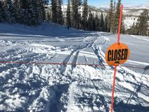 Closed ski run with tracks. A Deer Valley run is closed but some skiers went on it anyway as they could not resist skiing fresh powder Royalty Free Stock Images