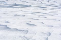 Snowy snow cover as background or texture stock images