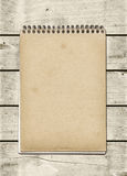 Closed spiral Note book on a white wood table Royalty Free Stock Images