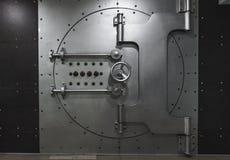 Closed steel bank vault door, close-up. Bank vault stock photos