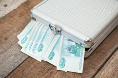 Closed steel case with Russian banknotes inside Stock Photo