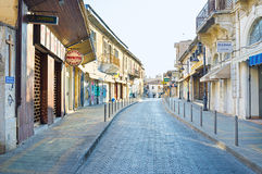 The closed stores. LIMASSOL, CYPRUS - AUGUST 6, 2014: The tourist streets are empty and all the stores are closed during the siesta, on August 6 in Limassol royalty free stock images