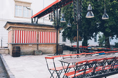 Closed street cafe, old tables and chairs on the street Royalty Free Stock Photography