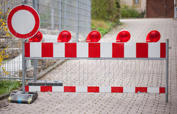 Closed street with construction sign barrier Stock Images