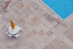 Closed sunshade at poolside Royalty Free Stock Photography