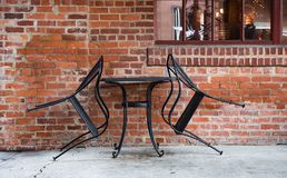 Closed table for two in an outdoor seating area at an urban restaurant. royalty free stock photo