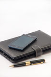 Closed tablet and android mobile phone and gold pen.  stock photography
