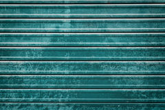 Closed teal roller door background Royalty Free Stock Image