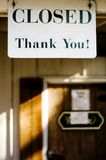 Closed thank you sign. Hanging in the doorway of a rural storefront Royalty Free Stock Photos
