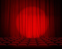 Closed theater red curtains with spotlight Royalty Free Stock Photo