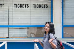 The closed ticket office. Disappointed woman stands before the closed ticket office royalty free stock images