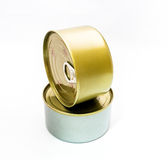 Closed tin can with open key Stock Images